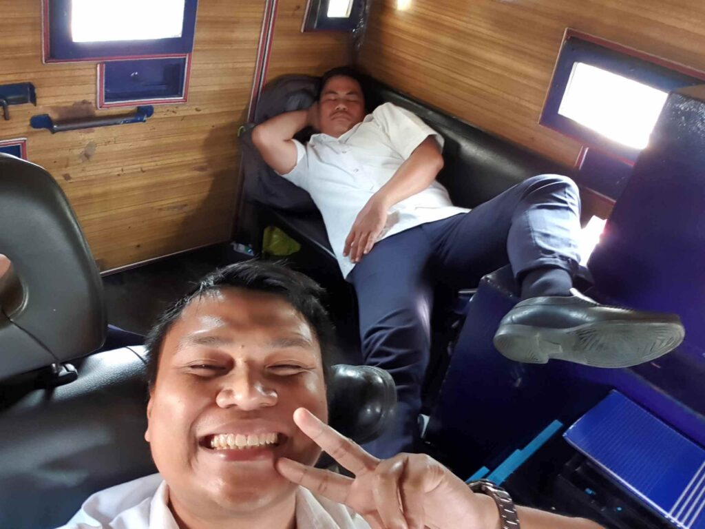 Riding in an armored car with a colleague
